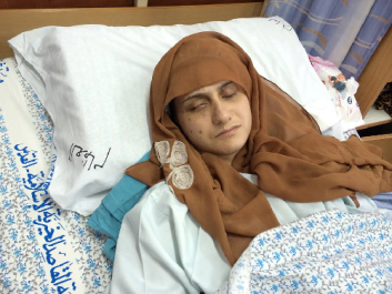 Yasmeen in Hospital Bed resized.png