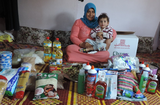 Family_receiving_emergency_food_parcel_in_Beqaa_Lebanon.png