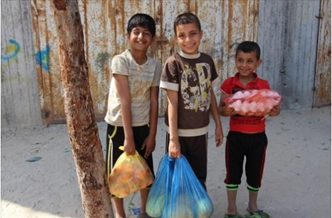 Children collecting food packages cropped.jpg