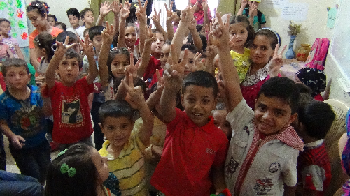 Children_receiving_kits_in_Beqaa.png