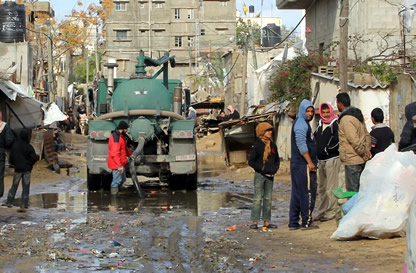 Clearing Sewage from streets in Gaza