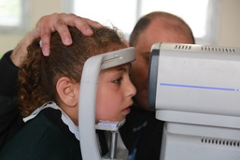 Amal having her eyes tested resized.jpg