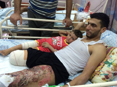Shadi and Bassam in Hospital Bed resized.png